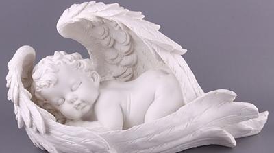 статуэтка в виде ангелочка