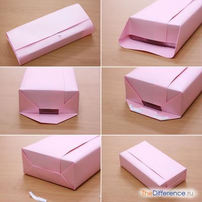 процесс упаковки коробки