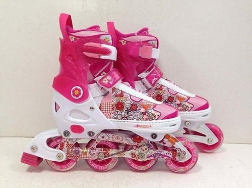 розовые роликовые коньки